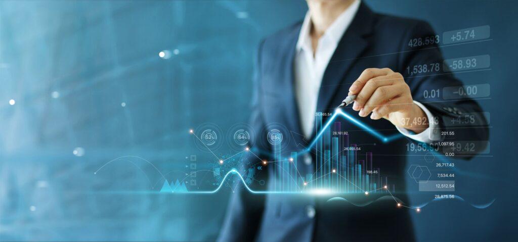 businessman-draw-growth-graph-progress-business-analyzing-financial (1)
